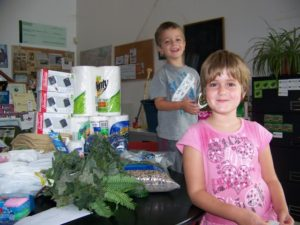 Rose, brother Connor, and donated supplies